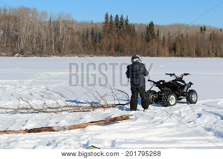 Pulling Firewood With A Quad To Make A Fire On The Ice