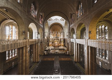 BRUSSELS BELGIUM - JUNE 19 2016: Wide picture of the interior of Koekelberg Basilica with many chairs and no people. Brussels.
