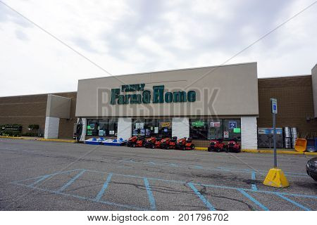 CADILLAC, MICHIGAN / UNITED STATES - JUNE 22, 2017: Family Farm and Home sells a wide variety of merchandise, including hardware, agricultural products, automotive parts, and pet supplies, in the Village at Wexford shopping center.