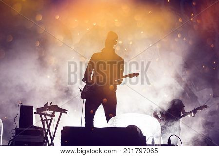 Guitarist in stage lights