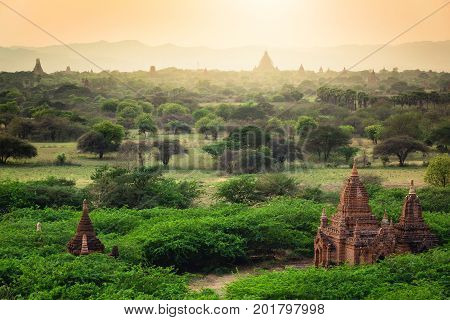 Sunrise with old temples and green lanscape Bagan Myanmar