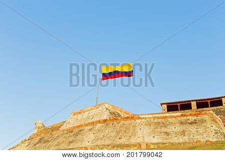 San Felipe de Barajas fortress with national flag in Cartagena Colombia. The Hill of San Lazaro with famous military fortress.