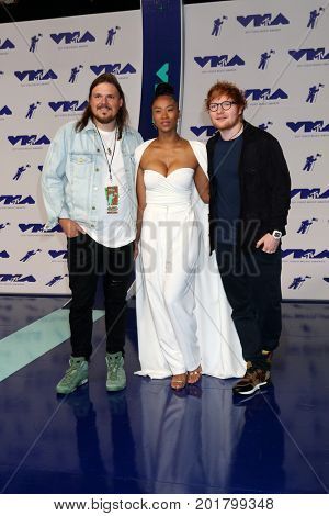 LOS ANGELES - AUG 27:  Guest, Jennie Pegouskie, Ed Sheeran at the MTV Video Music Awards 2017 at The Forum on August 27, 2017 in Inglewood, CA