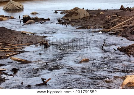 Discharge Of Water From Hydropower, River Bottom Was Exposed