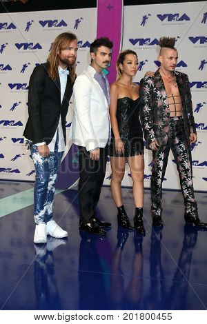 LOS ANGELES - AUG 27:  Jack Lawless, Joe Jonas, JinJoo Lee, Cole Whittle of DNCE at the MTV Video Music Awards 2017 at The Forum on August 27, 2017 in Inglewood, CA