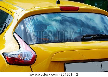 headlight of modern prestigious car closeup yellow color