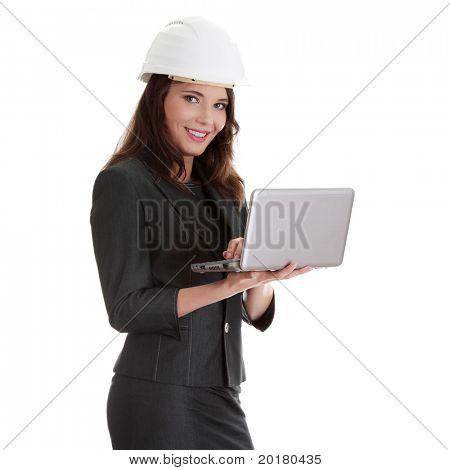 Smiling young female architect holding small laptop, isolated on white background
