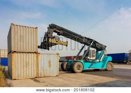 Lifting truck in operated at the container logistic yard. Cargo and shipping