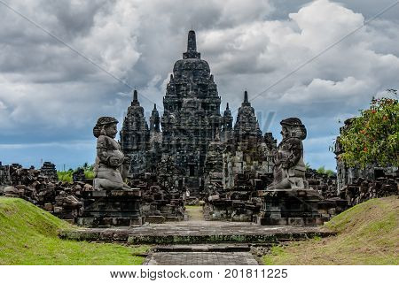 A view of the Candi Sewu complex with two statues of Dvarapala (guardian) at the entrance