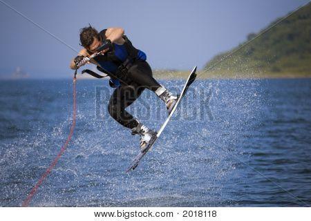 Jumping Wakeboarder In Water Splash