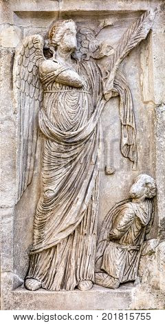 Stone Angel Arch of Constantine Rome Italy Arch built in 315 AD to celebrate Emperor Constantine's victory in 312 over co-emperor Maxenntius. Constantine attributed victory to vision of Jesus Christ made Christianity legal