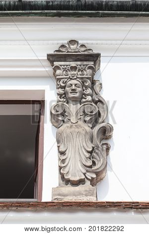 Bas-relief on the facade of the tenement house in the market Kazimierz Dolny Poland. City founded by King Casimir the Great in 14th century called the Pearl of the Renaissance poster