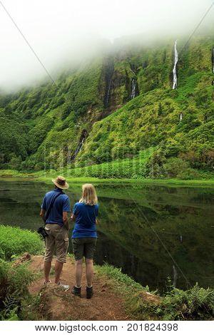 Trekkers admiring the Pozo da Alagoinha, also known as Pozo Ribeira do Ferreiro, Azores, Portugal, Europe