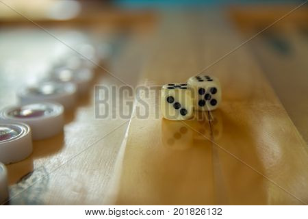 Dices for backgammon. Back gammon table game close up shot with selective focus.