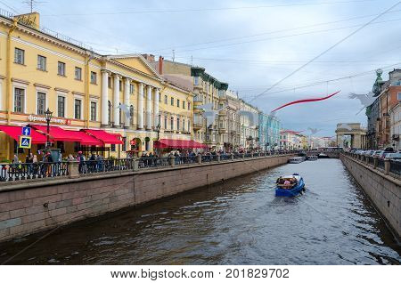 SAINT PETERSBURG RUSSIA - MAY 1 2017: Unknown tourists are on sightseeing boat on Griboyedov Canal during water walk along canals of St. Petersburg Russia