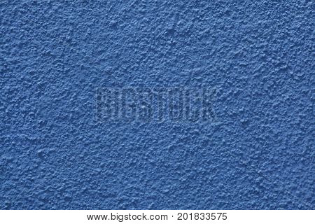 Blue painted stucco wall. Background texture.