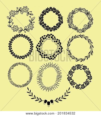 Hand drawn floral wreaths with leaves, flowers, and curlicues. Frame. Place for text