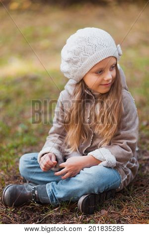 Portrait Of A Beautiful Little Girl In An Autumn Park