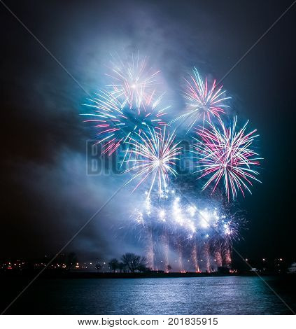 Beautiful, Colorful Fireworks Above The River During An Independence Day In Riga, Latvia.