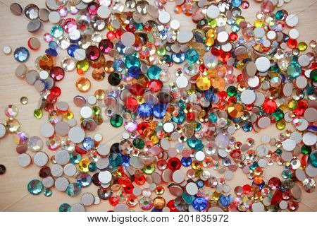Rhinestone background. Mix of Shiny rhinestones crystals texture as backdrop isolated white studio photo.