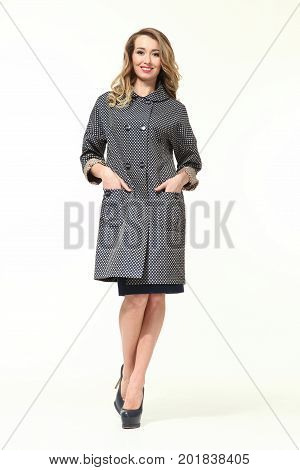 blond business woman in autumn trenchcoat  high heeled shoes full body portrait isolated on white