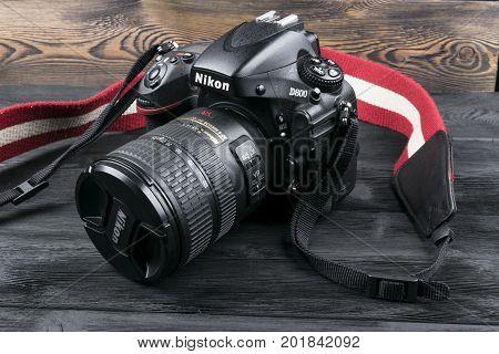 Sankt-Petersburg Russia August 28 2017 - Nikon D800 digital DSLR camera with Nikkor 24-120mm lens on black wooden background