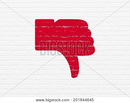 Social media concept: Painted red Thumb Down icon on White Brick wall background