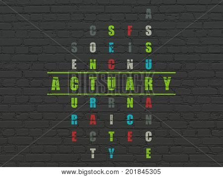 Insurance concept: Painted green word Actuary in solving Crossword Puzzle