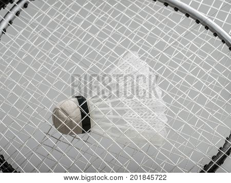 badminton racquets with a nylon shuttlecock trapped in between.