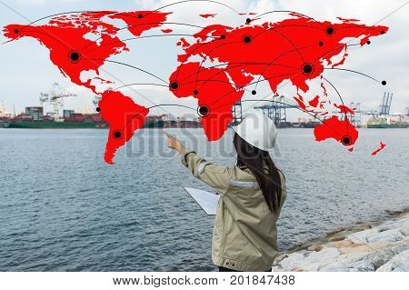 woman in suit world map and contacts. The concept of global contacts