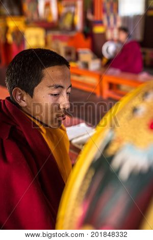 Ngawal, Nepal - May 6, 2016: Unidentified young buddhist monk praying in the monastery temple near Ngawal village, Nepal