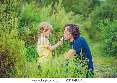Father And Son Use A Spray From An Allergy Because Of An Allergy To Ragweed