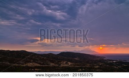 Stormy sky and sunrise at holy mountain Athos in Greece