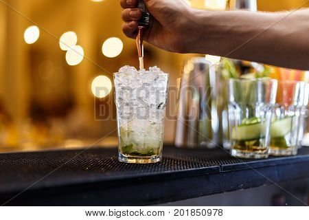 Barman Making Mojito