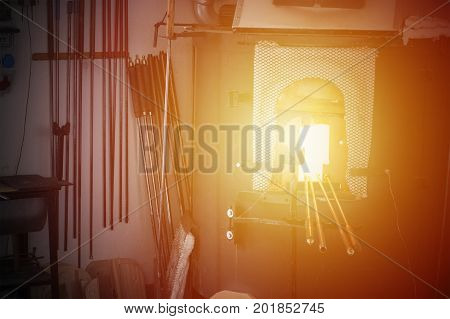 Glassblowing furnace with tools. Hot place of blacksmith