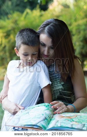 Mother and son reading a storybook. Family