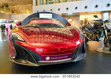 DOHA, QATAR - CIRCA MAY, 2017: red car on display at Hamad International Airport of Doha, the capital city of Qatar.