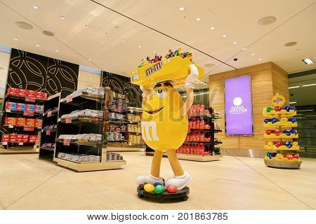 DOHA, QATAR - CIRCA MAY, 2017: M&M candy yellow character on display at Hamad International Airport of Doha, the capital city of Qatar.