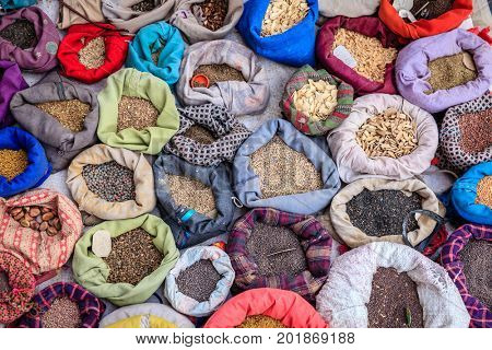 Bags with spices at a street market in Leh, Ladakh district of Kashmir, India