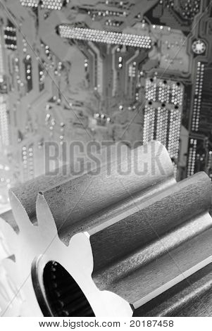 large gears against circuit-board idea in black/white