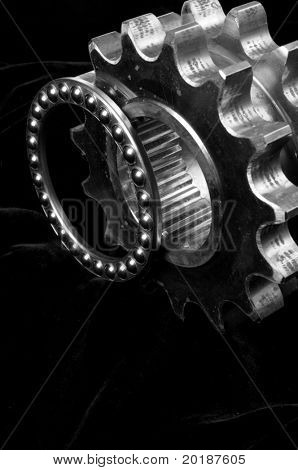 double-gears and ball-bearing against black velvet