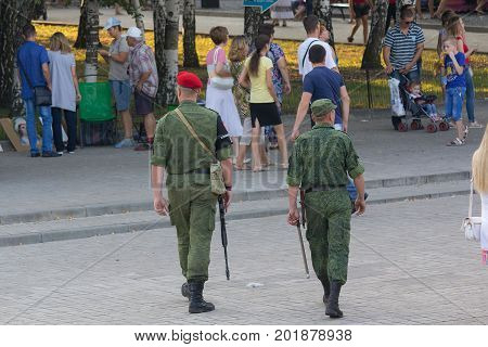 Donetsk Ukraine - August 27 2017: Armed patrol in the streets of the city during the celebration of the city's day