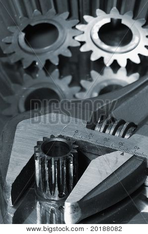 wrench and gear idea, focal-point on tip of wrench closest, all in a blue tone