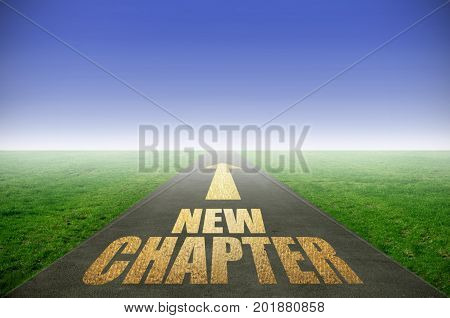 New chapter printed in gold on road with green grass on each side