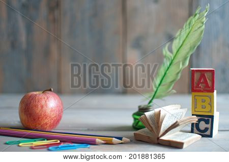 Stationery objects miniature book and apple with background space