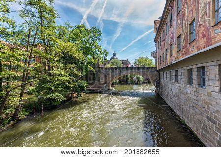 Bamberg Germany - May 22 2016: The wall of the old town hall and bridge in downtown of Bamberg Upper Franconia Bavaria Germany. Bamberg is under UNESCO protection.