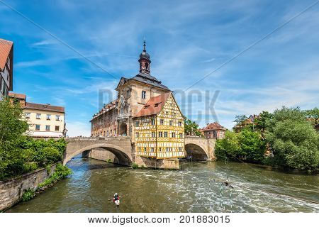 Bamberg Germany - May 22 2016: Scenic spring wide-angle view of the Old Town architecture with City Hall building in Bamberg Germany.