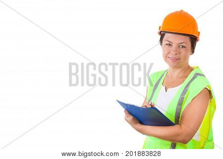 Attractive Woman Worker in Safety Jacket and Yellow Helmet Holding Clipboard on a white background