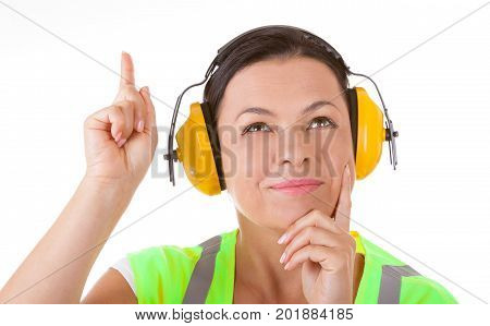 Attractive Woman Worker in Safety Jacket and Protective Ear Headphones get in Idea on a white background