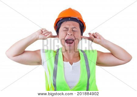 Screaming Attractive Woman Worker in Safety Jacket and Yellow Helmet with Closed Eyes and Ears on a white background